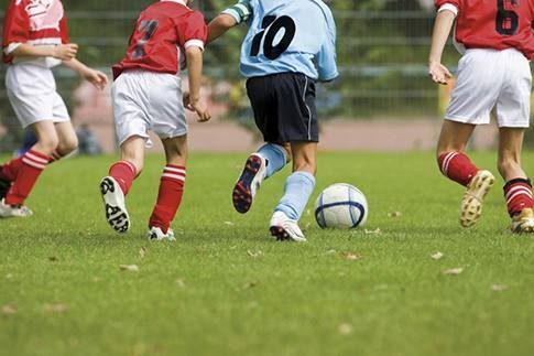 Photo of Young boys tend to benefit from sports
